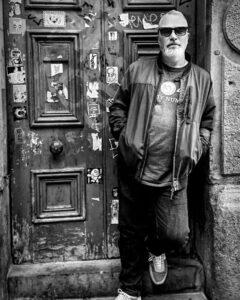 Trustee Andy Roberts, standing in a doorway